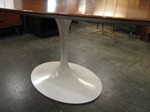 Saarinen Walnut Top Oval Tulip Dining Table from Knoll