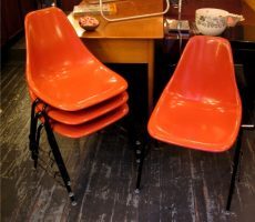 Set of Four Stacking Orange Shell Chairs
