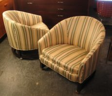 Pair of Low Barrel Back Club Chairs on Wheels