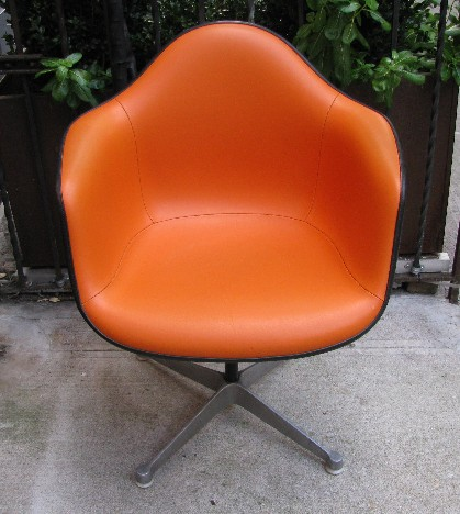 Set of Four Eames Orange Upholstered Arm Shell Swivel Chairs