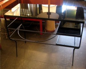 "1950s Iron and Reverse Painted Glass Desk This Iron and Reverse Painted Glass Desk after Frederick Weinberg is from the 1950s. The modest design has great lines using a minimum of materials. Perhaps by Salterini or Weinberg. It is in excellent condition and measures 18 X 38 1/2 X 28 3/4""h."