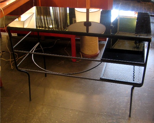 """1950s Iron and Reverse Painted Glass Desk This Iron and Reverse Painted Glass Desk after Frederick Weinberg is from the 1950s. The modest design has great lines using a minimum of materials. Perhaps by Salterini or Weinberg. It is in excellent condition and measures 18 X 38 1/2 X 28 3/4""""h."""
