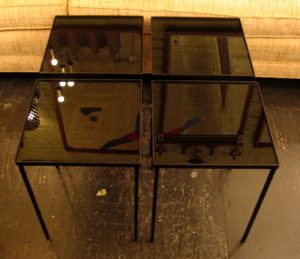 Set of Four 1950s Iron and Glass Stacking Tables